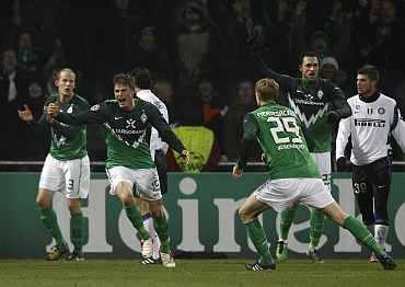 Werder Bremen's Sebastian Proedl celebrates after scoring against Inter Milan during their Champions League Group A match at the Weser stadium