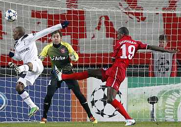 Tottenham Hotspur's Jermain Defoe tries to score past FC Twente's goalkeeper during their Champions League Group A match in Enschede