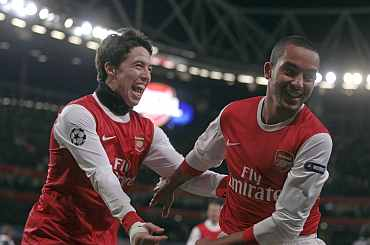 Arsenal's Theo Walcott and Samir Nasri celebrate after scoring a goal against Partizan Belgrade during their Champions League match at the Emirates Stadium