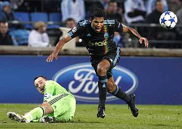 Olympique Marseille's Brando fights for the ball with Chelsea's John Terry during their Champions League match