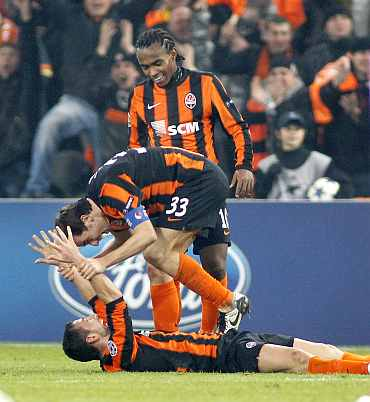 Shakhtar Donetsk 's Razvan Rat celebrates with team-mates after scoring against Braga