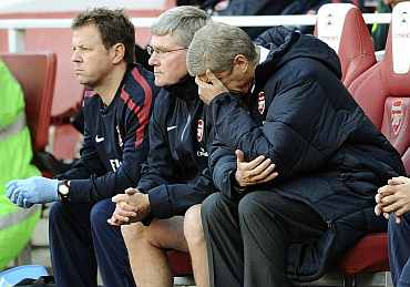 Arsene Wenger reacts during a match