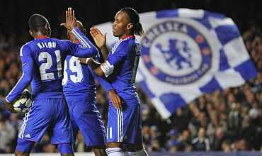 Chelsea players celebrate after a goal during a match