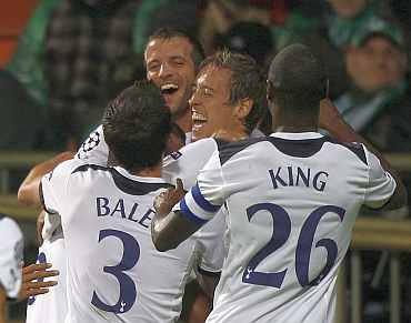 Tottenham Hotspurs players celebrate during a match