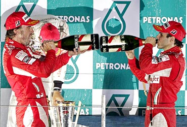 Ferrari drivers Fernando Alonso (left) and Felipe Massa