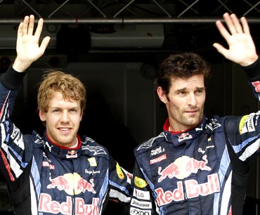 Red Bull drivers Sebastian Vettel (left) and Mark Webber
