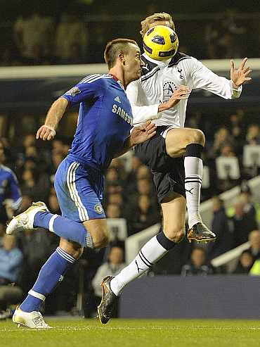 Chelsea's John Terry challenges Tottenham Hotspurs' Peter Crouch duing their EPL match