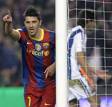 Barcelona's David Villa celebrates after scoring against Real Sociedad