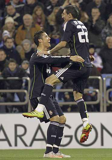 Real Madrid's Cristiano Ronaldo and Angel Di Maria after scoring a goal against Real Zaragoza