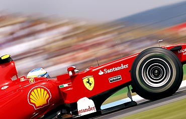 Fernando Alonso steers his Ferrari car