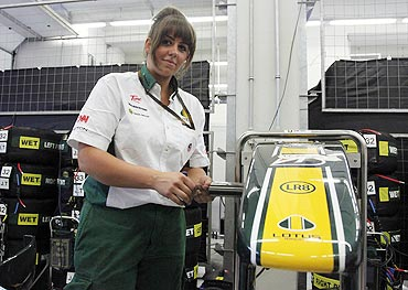 Lotus Formula One mechanic Antonia Scott of Britain works at her team's pit box