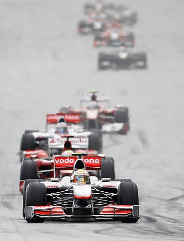 McLaren's Hamilton leads the pack at an F1 race