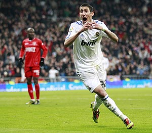 Real Madrid's Angel Di Maria (right) celebrates his goal against Sevilla