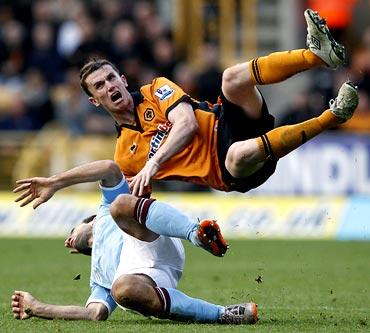 Manchester City's Pablo Zabaleta (left) fouls Wolverhampton Wanderers' Kevin Foley