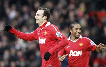Berbatov celebrates with Anderson after scoring the second goal