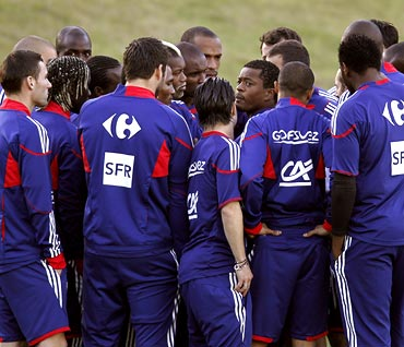 France football captain Patrice Evra (centre) speaks to his team-mates