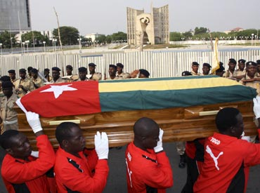 Pallbearers carry the coffin of Togolese assistant soccer coach Amalete Abalo during the funeral service in Lome, on January 15, 2010