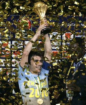Egypt's captain Ahmed Hassan holds the trophy after his side's victory in their African Nations Cup final soccer match against Ghana