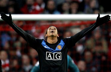 Manchester United's Nani celebrates after scoring a goal