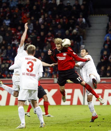 Bayer Leverkusen's Stefan Kiessling (centre) scores a goal against Freiburg