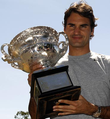 Roger Federer poses with the Australian Open trophy