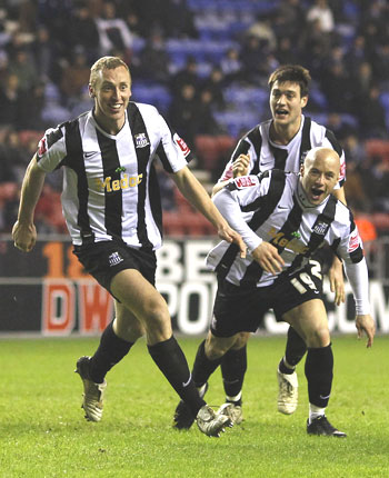 Notts County's Stephen Hunt (left) celebrates with team-mates after scoring against Wigan Athletic during their FA Cup match on Tuesday
