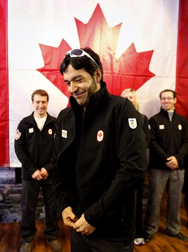 Brian McKeever puts on his Team Canada Olympic jacket after he was named in the Olympic Cross Country ski team