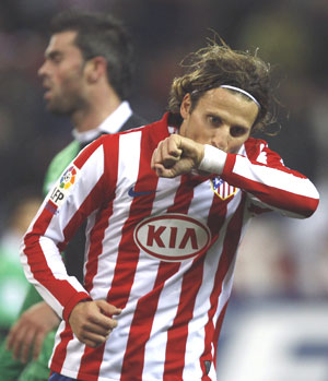 Atletico Madrid's Diego Forlan celebrates after scoring against Racing Santander during their King's Cup semi-final first leg on Thursday