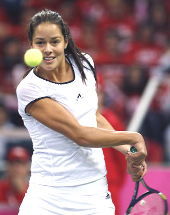 Serbia's Ana Ivanovic hits a return against Russia's Svetlana Kuznetsova during their Fed Cup tie on Saturday