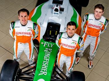 Adrian Sutil (left), Vitantonio Liuzzi (centre) with test driver Paul di Resta