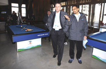 IOC President Rogge (left) tours a recreation room at athletes' village in Vancouver