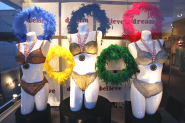 Mannequins are displayed with Olympic rings in a lingerie shop in Vancouver
