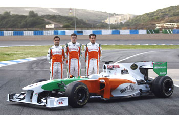 Force India drivers pose next to their car during the official presentation of the Force India Formula One Team 2010 at the Jerez racetrack on Wednesday