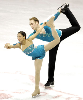 Mark Ladwig (right) and Amanda Evora compete during the championship pairs free skate in the US Figure Skating Championship