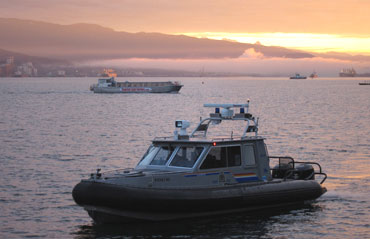 A Royal Canadian Mounted Police boat patrols along Burrard Inlet ahead of the 2010 Winter Games in Vancouver