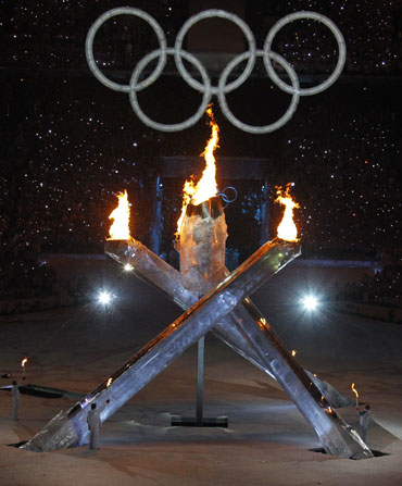 The Olympic flames burn in the stadium during the opening ceremony of the Vancouver 2010 Winter Olympics