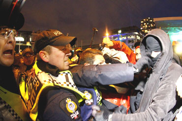 Protestors scuffle with police outside the BC Place before the start
