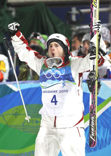 Canada's Alexandre Bilodeau celebrates after seeing his score during the men's freestyle skiing mog