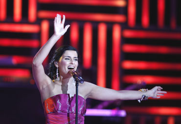 Canadian singer Nelly Furtado performs at a medal ceremony on Sunday