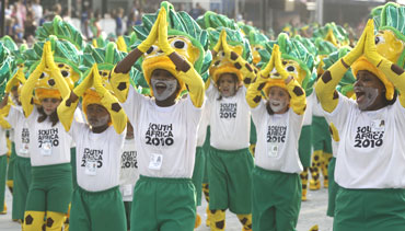 Revellers wearing South Africa World Cup 2010 shirts parade during a carnival in Sao Paulo on Saturday