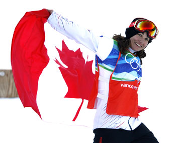 Canada's Maelle Ricker celebrates after winning the gold medal in the women's snowboard cross