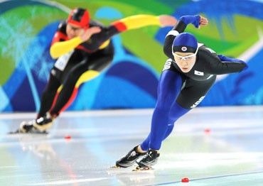 Lee Sang-Hwa of South Korea (right) and Wolf of Germany compete in the women's 500 metres speed skating race
