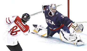 US goalie Ryan Miller blocks a shot from Switzerland's Julien Sprunger during their men's ice hockey game