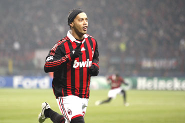 AC Milan's Ronaldinho celebrates after scoring against Manchester United