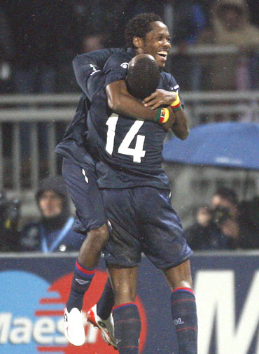 Olympique Lyon's Jean Makoun (left) celebrates with team-mate Sidney Govou after scoring against Real Madrid