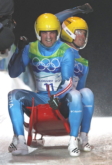 Austria's Andreas Linger and Wolfgang Linger celebrate after finishing their final run of the men's doubles luge event