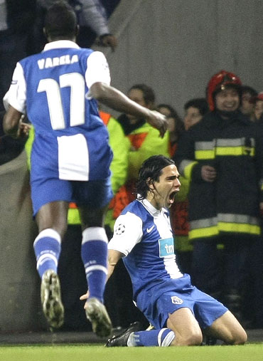 Porto's Radamel Falcao (right) is ecstatic after scoring the winner against Arsenal