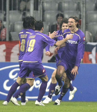 Fiorentina's Kroldrup (right) celebrates with team-mates after scoring the equaliser