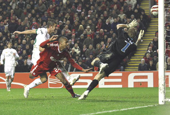 David Ngog heads the ball into the net
