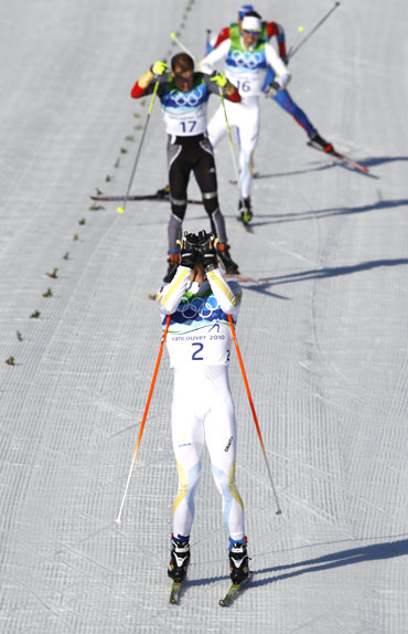 Sweden's Marcus Hellner gets emotional after crossing the finish line of the men's 30 km pursuit cross-country final